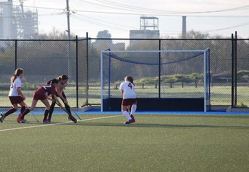 Hockey match in progress with girls participating